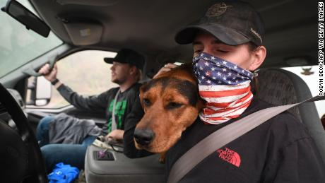 James Smith hugs his dog, Rose, after returning to his evacuated home in Estacada, Oregon, on Saturday.