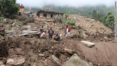 Residents and rescue workers search for landslide victims in Sindhupalchok District.