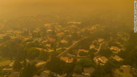 An aerial view shows neighborhoods in Monrovia, California shrouded in smoke as the Bobcat Fire advanced on September 13.