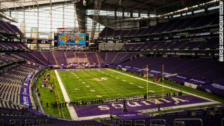 The Minnesota Vikings stand with arms linked as the team pays tribute to George Floyd before the game against the Green Bay Packers at U.S. Bank Stadium on Sunday, September 13.