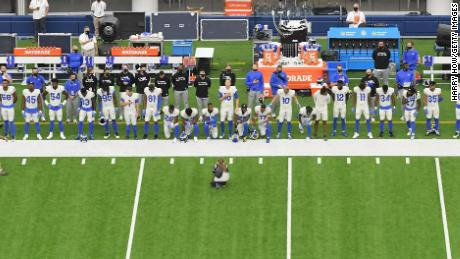 A general view of the Los Angeles Rams sideline during the National Anthem before the game between the Dallas Cowboys and the Rams at SoFi Stadium on Sunday, September 13.