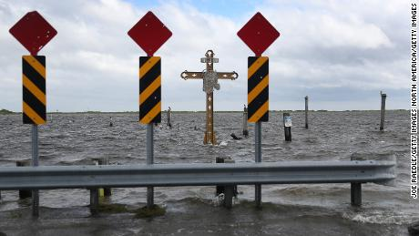 A cross honoring those killed by Hurricane Katrina stands in the Mississippi River-Gulf Outlet before the arrival of Hurricane Sally.