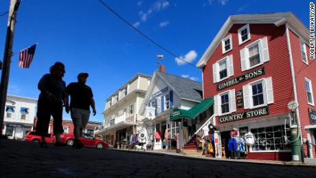 Tourists walk by shops in Boothbay Harbor, Maine in June. By early September, Maine's economy was operating at 93% of where it was before the pandemic, according to the Back-to-Normal Index. (AP Photo/Robert F. Bukaty)