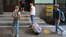 Students wearing masks arrive on September 14 for the start of the school year at the Luigi Einaudi technical high school in Rome, Italy.