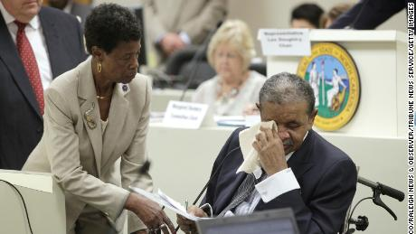 North Carolina state Rep. Larry Womble wipes away tears in 2012 as he tells his fellow legislators to do what's right and approve funding for a program to provide compensation for victims of North Carolina's forced sterilization program.
