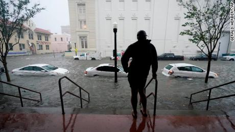 Floodwaters surround cars Wednesday morning in Pensacola, Florida.