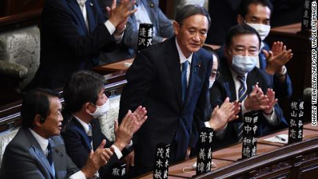 Yoshihide Suga is applauded after he was elected as Japan's Prime Minister by the lower house of the Diet in Tokyo on September 16.