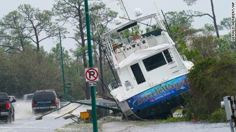 A boat is washed up near a road after Hurricane Sally in Orange Beach, Alabama.