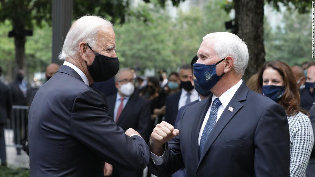 Biden greets Vice President Mike Pence as they attend a ceremony at the 9/11 Memorial in New York City.