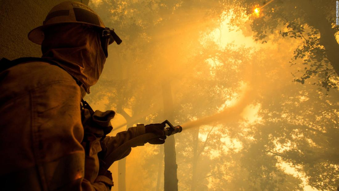 A firefighter battles the Bobcat Fire while defending the Mount Wilson observatory in Los Angeles on September 17.