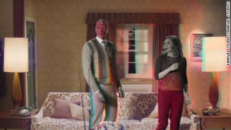 "Paul Bettany (left) is Vision and Elizabeth Olsen (right) is Wanda Maximoff in Marvel Studios' ""WandaVision."""