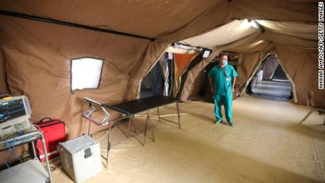 An Italian medic walks around the coronavirus ward of a field hospital on the Lebanese University campus in Hadath on September 8.