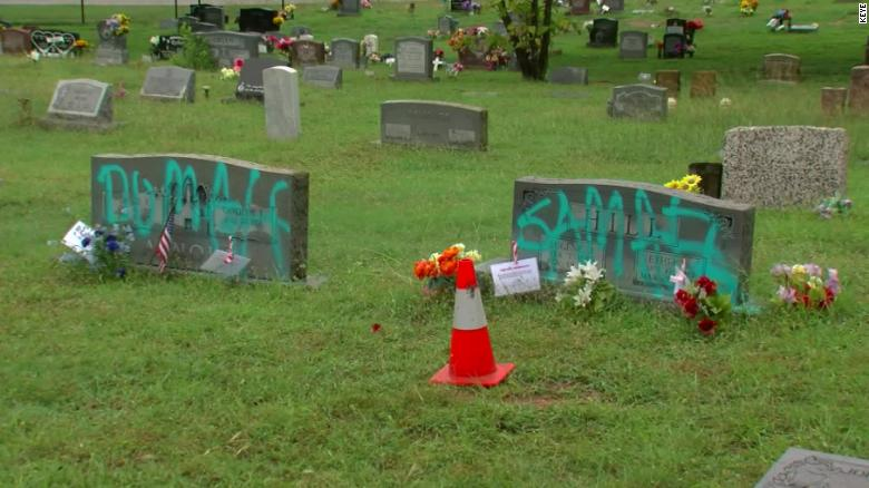 Somebody spray-painted graffiti on headstones in a historically Black cemetery in Austin, Texas
