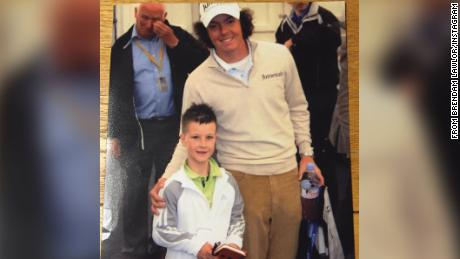 Lawlor poses with Northern Irish golfer Rory McIlroy.