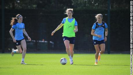 Manchester CIty's Rose Lavelle, Sam Mewis and Janine Beckie in action during training at Manchester City.