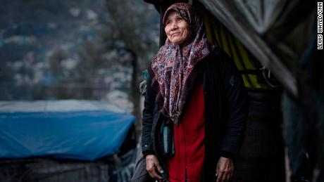 A woman stands outside her tent in the Moria refugee camp in Lesbos, Greece in February 2020.