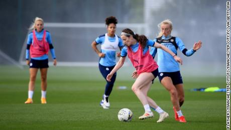 Manchester CIty's Rose Lavelle shields the ball in training.