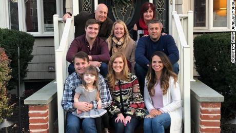 Nicholas Gismondi smiles with his wife, Mary Jane, and their family.