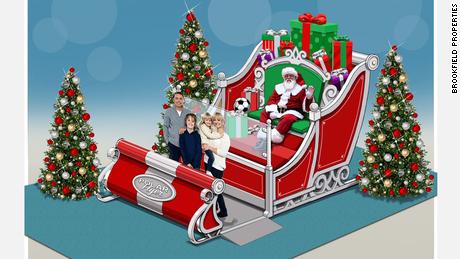 Christmas Covid Christmas: Mall Santas بچه ها را از پشت گلوله های برفی شیشه ای اکریلیک می بیند