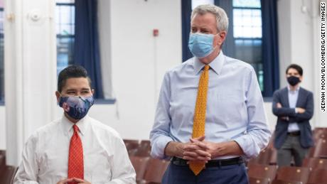 Richard Carranza, chancellor of the New York City Department of Education, and  Bill de Blasio, mayor of New York, attend a news conference at an elementary school in Brooklyn on Aug. 19, 2020.