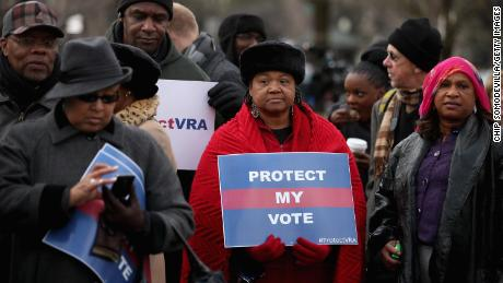 Alabama residents pictured standing in line outside the U.S. Supreme Court for the chance to hear oral arguments in Shelby County v. Holder on February 27, 2013 in Washington, DC. In this case, the Supreme Court struck down a provision of the landmark Voting Rights Act that required certain states and localities with a history of racial discrimination to first get federal approval of any changes to voting laws and practices before they took effect.(Credit: Chip Somodevilla/Getty Images)