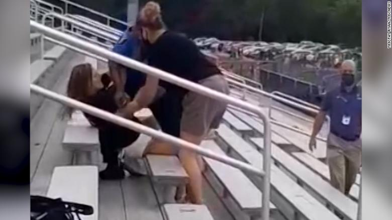 Woman TASED & arrested after refusing to wear mask at school football game