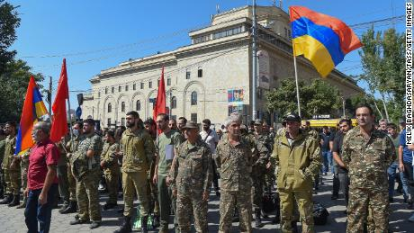Servicemen are pictured in Yerevan, Armenia, 일요일에, the day the Armenian government imposed martial law and general mobilization after clashes with Azerbaijan.