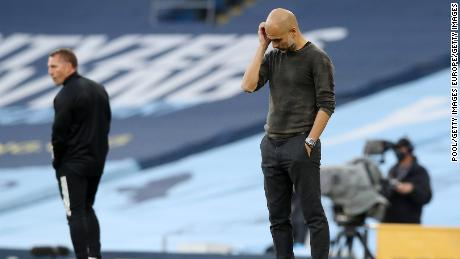 Guardiola looks dejected during the match against Leicester City.