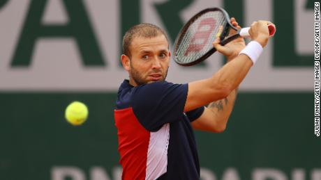 Evans plays a backhand during his defeat by Kei Nishikori at the French Open.