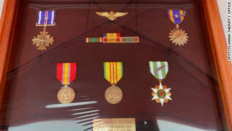 The shadowbox contained replacements of his medals, ribbons and pilot's wings.