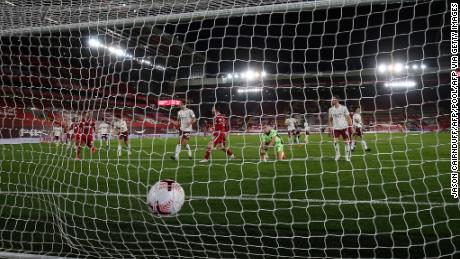 The ball hits the back of the net after Liverpool's Andrew Robertson scores his team's second goal against Arsenal.