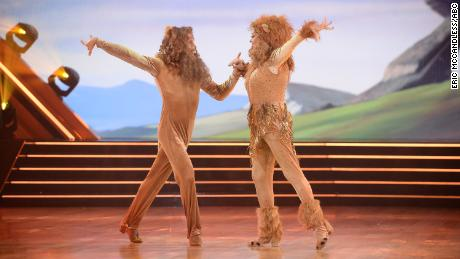 "Carole Baskin and her partner Pasha Pashkov were sent home from ""Dancing with the Stars"" after a somber samba to ""Circle of Life"" in full lion garb."