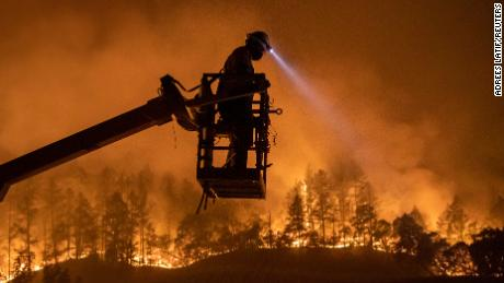 The Glass Fire burns in Calistoga, California on September 28, 2020. An unprecedented fire season in the American West in 2020 was just one of an onslaught of climate-related disasters that have swept the country in recent years.
