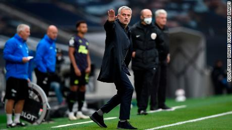 Mourinho gestures on the sidelines during Tottenham's game against Chelsea.
