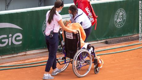 Bertens is taken off the court in a wheelchair after winning her marathon match against Errani.