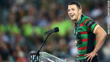 Burgess receives the Clive Churchill medal after the NRL Grand Final in 2014.