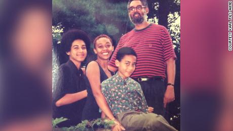 Fils-Aimé standing with his three children, Karl, Gerard and Erica.