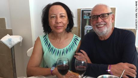 Fils-Aimé smiling with his wife, Marise.