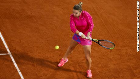 Halep returns the ball to Anisimova during their third round match at the French Open.