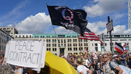 A protester waves a QAnon conspiracy flag at the Berlin protest on August 29.