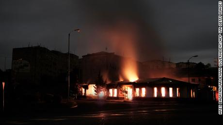 In this image, distributed by the Armenian government, a building burns after recent shelling during the ongoing fighting between Armenia and Azerbaijan over the breakaway Nagorno-Karabakh region, in the city of Stepanakert early on October 4.