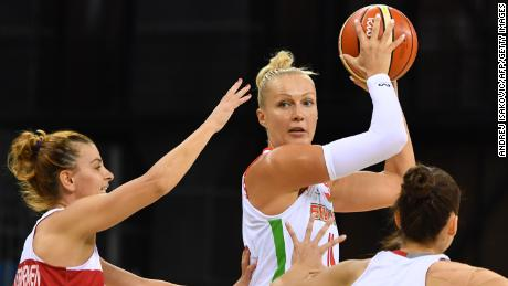 Leuchanka (middle) holds the ball between Turkey's point-guard's Birsel Vardarli Demirmen (left) and Olcay Cakir (right).