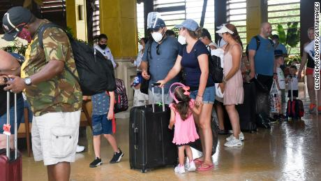 Tourists are evacuated from their hotel in Puerto Morelos, Quintana Roo State, Mexico, in preparation for the arrival of Hurricane Delta.