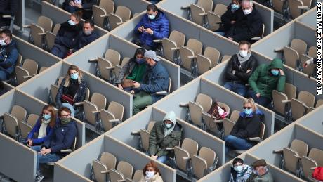 Spectators watch Nadal in action.