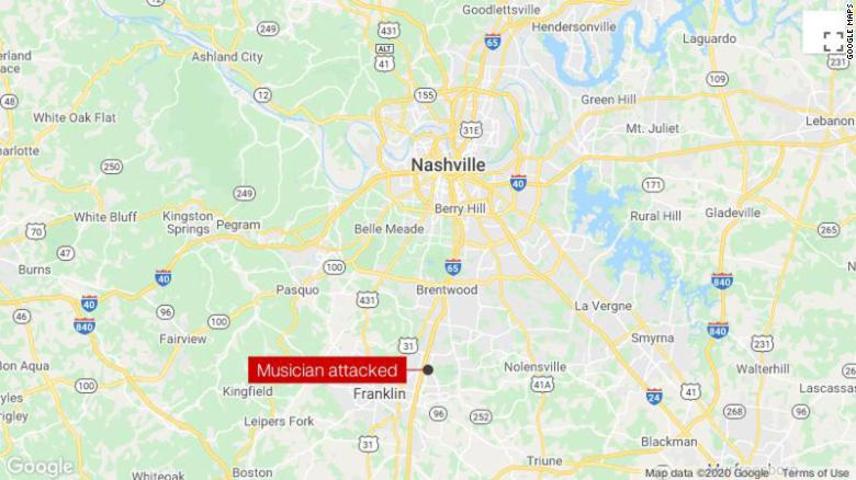 A musician with a Latin country-rock band says he and a friend were beaten at a Tennessee bar for speaking Spanish