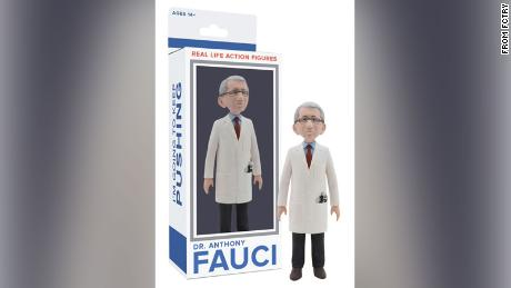 Dr. Fauci's figurine is dressed in a white coat and removable mask.