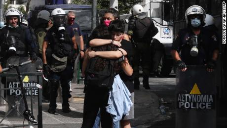 Protesters at the anti-fascist rally, embrace each other following the announcement of the verdict, outside the courthouse in Athens on Wednesday.