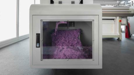 The Looop machine dissemble old clothing, shreds it, turns it into yarn, which then is used to make new clothing.