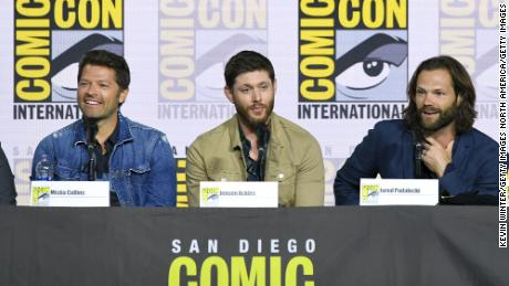 "Misha Collins, Jensen Ackles, and Jared Padalecki speak at the ""Supernatural"" panel during 2019 Comic-Con International at San Diego Convention Center on July 21, 2019 in San Diego, California. The show became a major draw during the annual event, taking over the largest venue, Hall H, for several years."