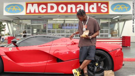 Travis Scott surprises crew and customers at McDonald's for the launch of the Travis Scott Meal on September 8, 2020 in Downey, California.